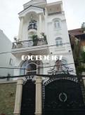 Nhà mặt tiền chợ Bình Khánh, 1 trệt, 2 lầu, 4 phòng ngủ. Gía 30tr/th